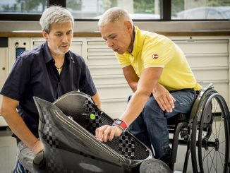 Para athlete Andrea Eskau works with Toyota engineers as they review equipment under development.